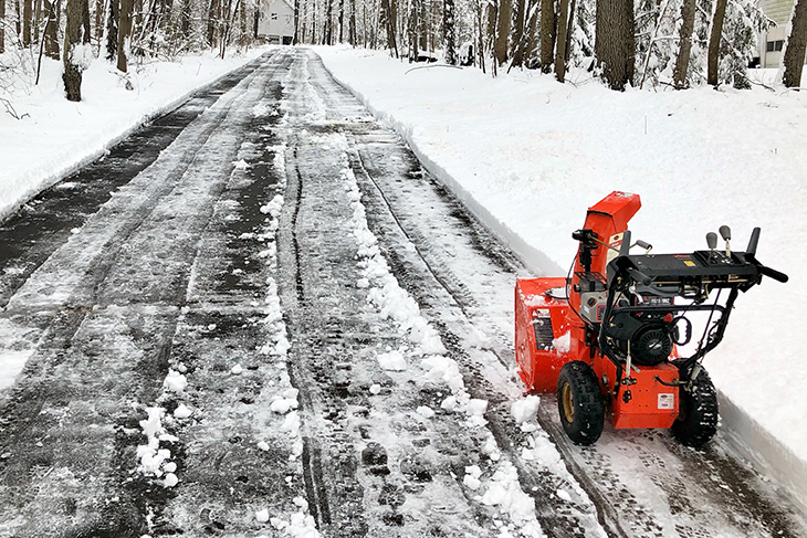 Snowblower making driveway passible in winter