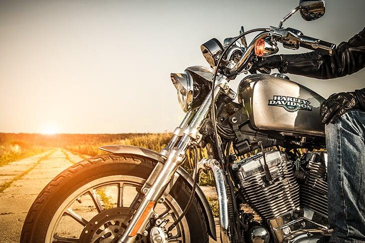 Biker riding a Harley Davidson motorcycle