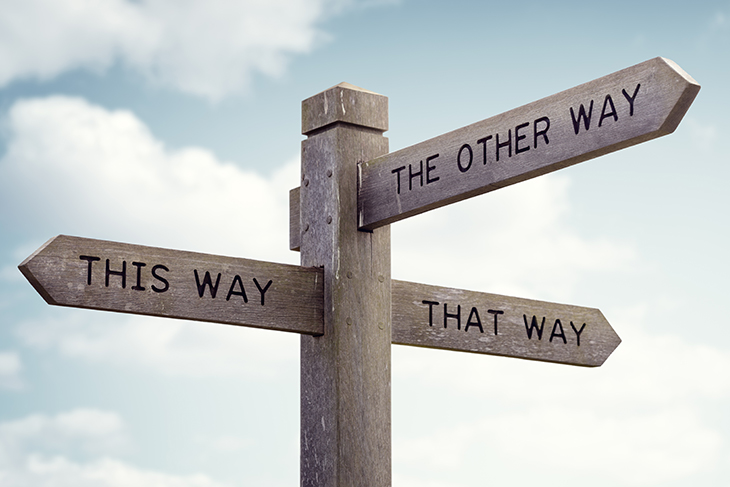 """Three-way directional sign pointing """"this way,"""" """"that way,"""" and """"the other way"""""""