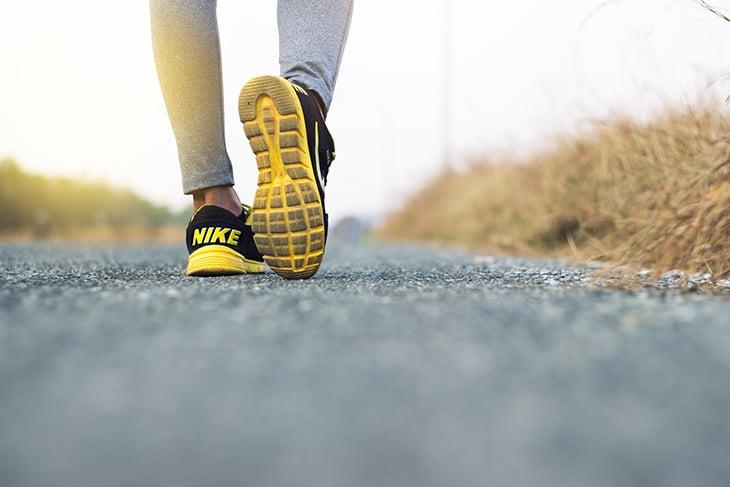 Low shot of female running wearing Nike shoes