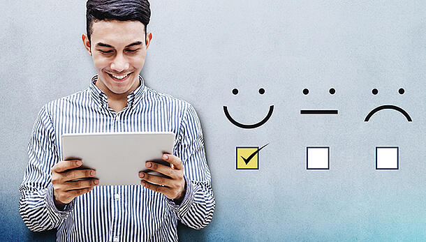 male on tablet with three smile emojis